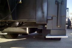 Stabilizer foot pads are angled slightly down toward the middle of the truck.